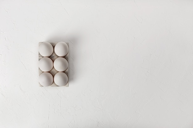 Chicken eggs on a white background. top view. copyspace