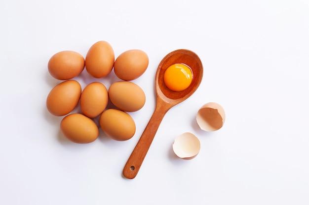 Chicken eggs with yolk on white background.