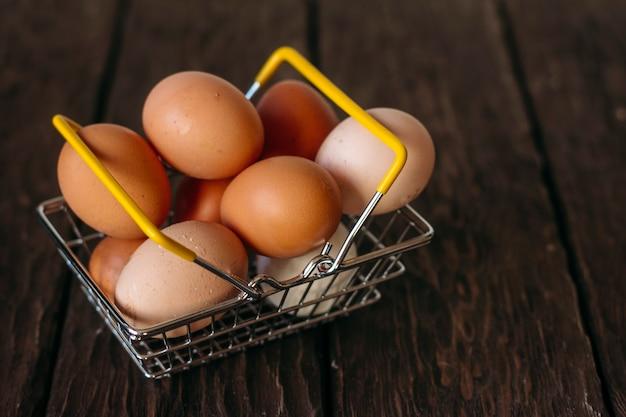 Chicken eggs on a wooden background