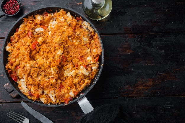 Chicken enchiladas, served in casserole, on old dark  wooden table background, top view flat lay with copy space for text
