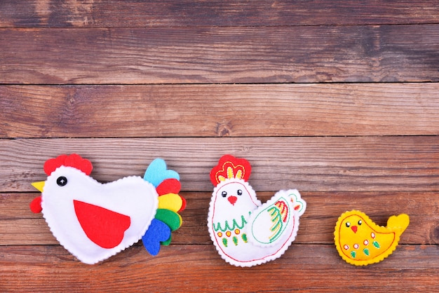 The  chicken family on the wooden background