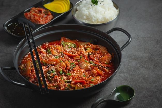 Chicken fried in hot pot with spicy sauce in korean style