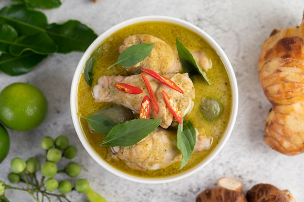 Chicken green curry in a bowl .