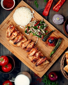 Chicken kabab with grilled hot pepper and tomatoes, greens, and rice