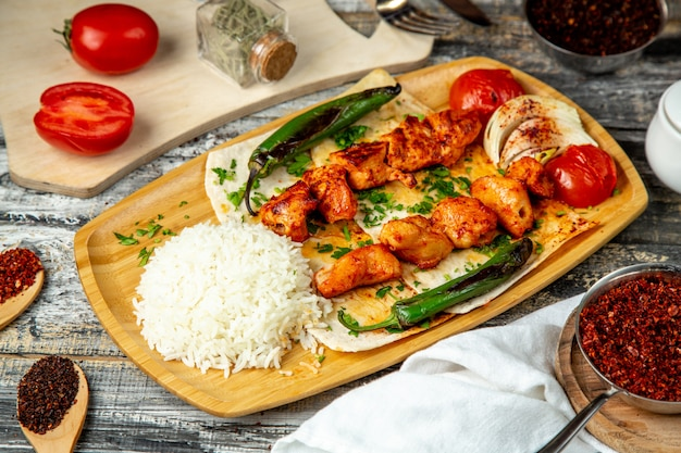 Chicken kebab  with rice  pepper  side view