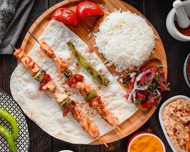 Chicken kebab with rice top view