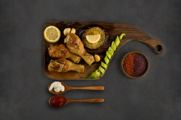 Chicken legs barbecue with spices and sauces