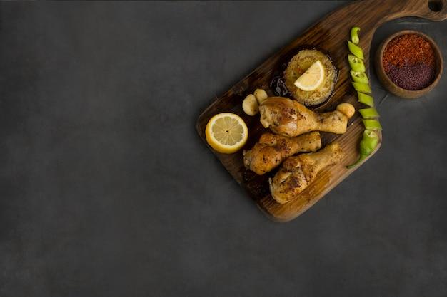 Chicken legs grilled and served with herbs and spices