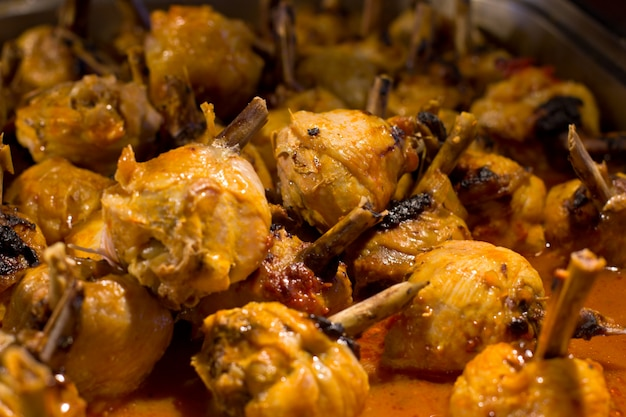 Chicken legs in a sauce, baked on a grill