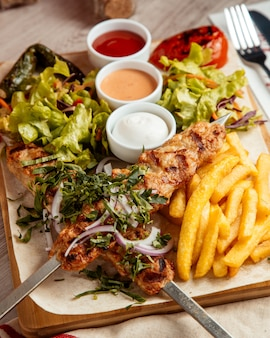Chicken lula  french fries  salad  side view
