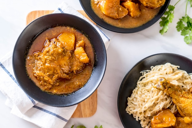 Chicken massaman curry paste with noodle