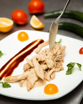 Chicken meat slices in creamy sauce