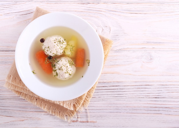 Chicken meatballs soup with carrot and potato