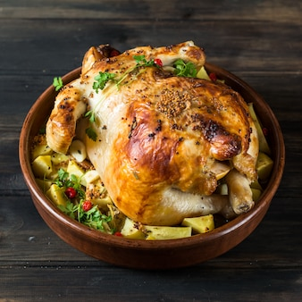 Chicken mushroom and potatoes in a baking dish. baked turkey. christmas dish.