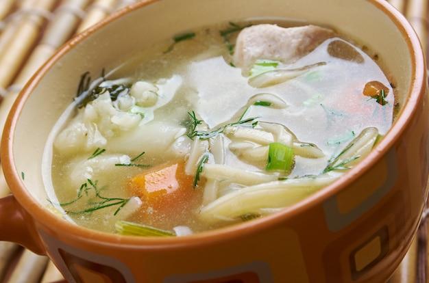 Chicken noodle soup broth closeup