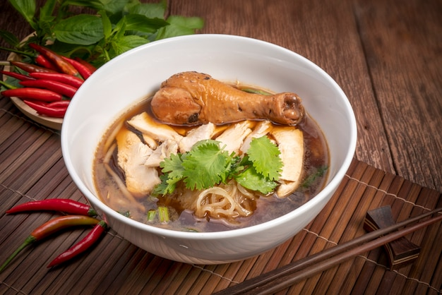 Chicken noodle with black soup.thai style.