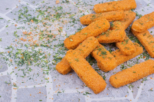 Chicken nugget sticks with herbs and spices.