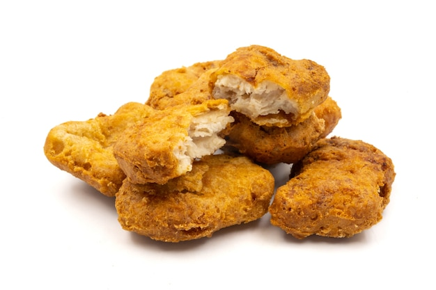 Chicken nuggets on a white background.