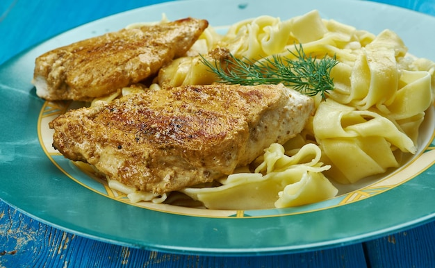Chicken piccata with pasta, made with a tangy and savory lemon and white wine sauce .