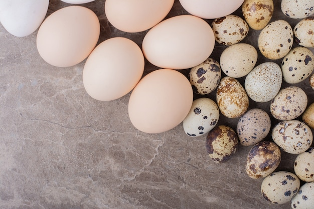 Chicken and quail eggs on the ground