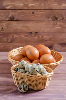 Chicken and quail eggs  rustic on background