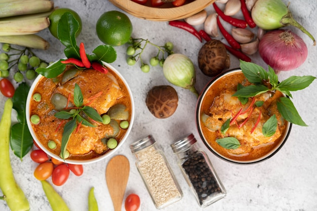Chicken red curry in a black cup