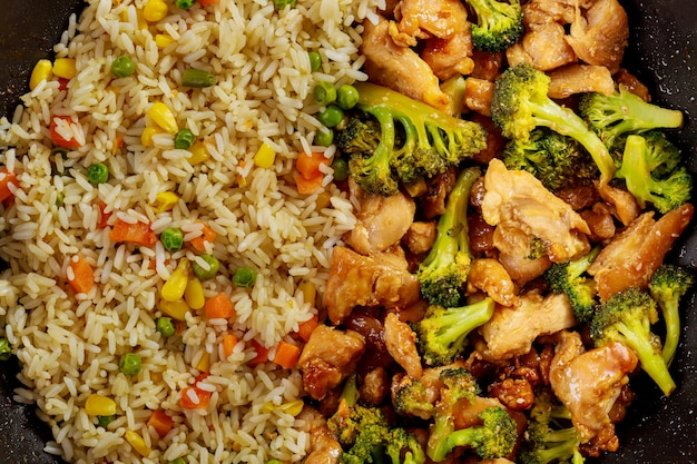 Chicken, rice and broccoli close up