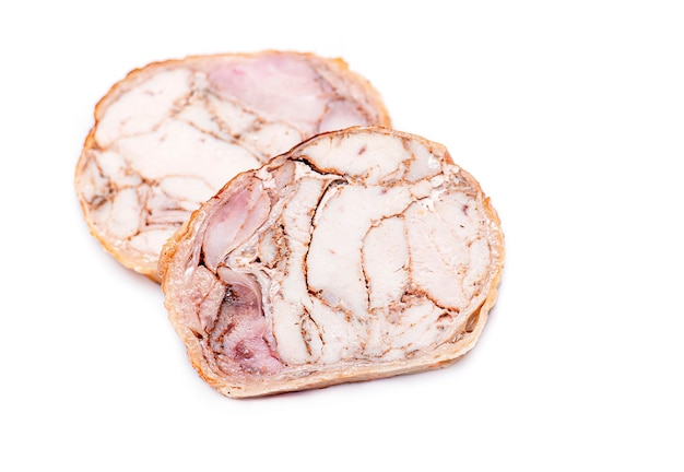 Chicken roll. slices of meat roll isolated on white