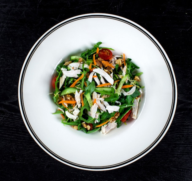 Chicken salad with arugula and nuts
