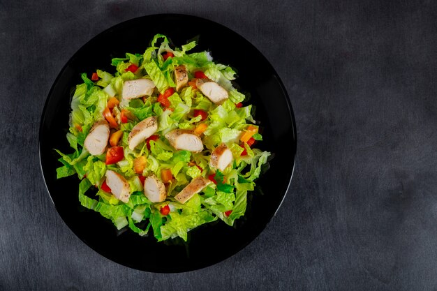 Chicken salad with cherry tomatoes, onion, fresh healthy eating