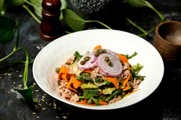 Chicken salad with onion, greens, and carrot