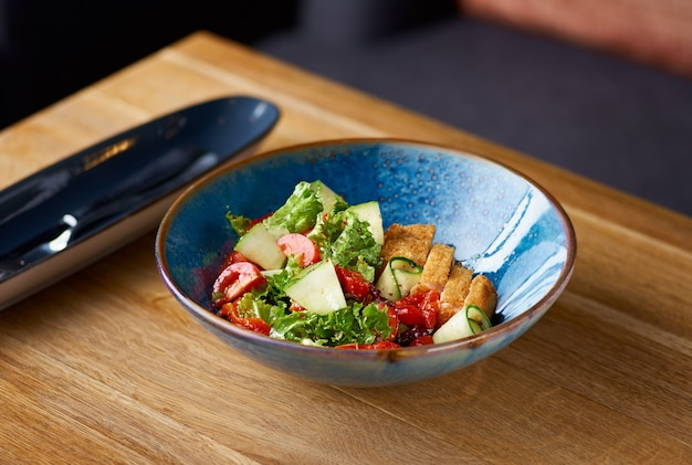 Chicken salad with tomatoes and cucumber on the table