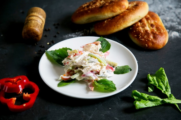 Chicken salad with vegetables and mayonnaise
