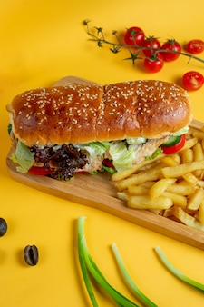 Chicken in sesame bread with side fries