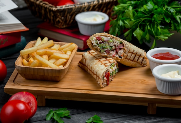 Chicken shaurma, lavash stuffed with meat and vegetables served with dip sauces