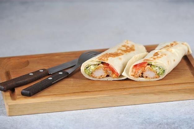 Chicken shawarma on wooden board