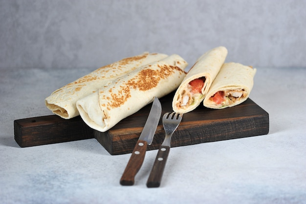 Chicken shawarma on wooden board