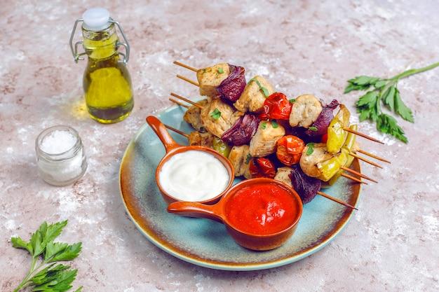Chicken shish kebab with vegetables,ketchup,mayonnaise