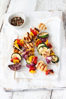 Chicken skewers with onions