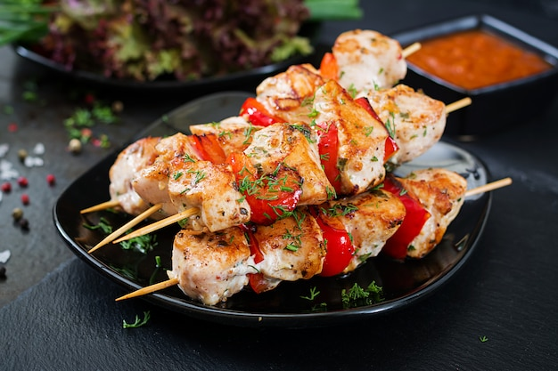 Chicken skewers with slices of sweet peppers and dill. tasty food. weekend meal.