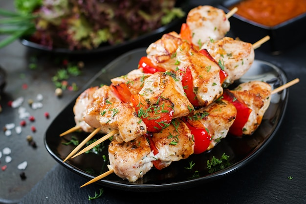 Chicken skewers with slices of sweet peppers and dill