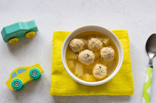 Chicken soup for children in white bowl healthy baby food