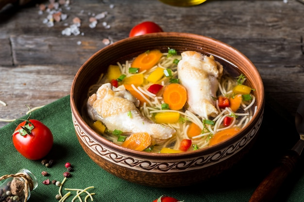 Chicken soup with vegetables. healthy food. traditional dish. carrot dish. pasta soup. minestrone soup