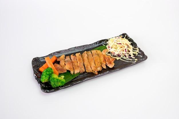Chicken steak with pepper salt and cabbage salad
