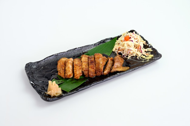 Chicken steak with teriyaki sauce and cabbage salad