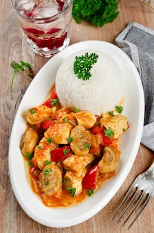 Chicken stew with mushrooms served  with rice