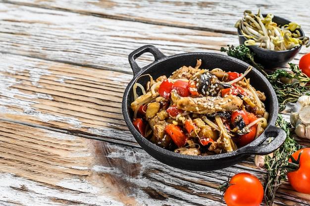 Chicken stir-fry in a pan. .