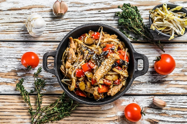 Chicken stir-fry in a pan