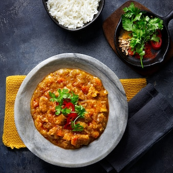 Chicken tikka masala spicy curry meat food in marble plate