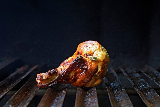 Chicken wing thigh on the barbecue grill